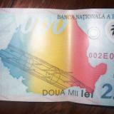 Bancnota 2000 lei eclipsa 1999