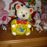 ursuletul tommy..lampa veghe, carusel, ceas..interactiv ( in timp ce canta si lumineaza capul se balanseaza, canta un canTec de leagan, p