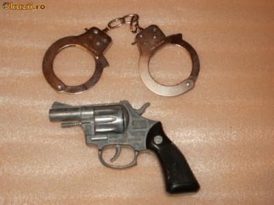 jucarii jucarie pistol din metal cu catuse de jucarie foto