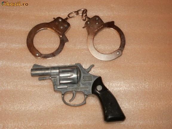 jucarii jucarie pistol din metal cu catuse de jucarie foto mare