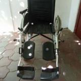 Carut handicap pentru persoane cu dizabilitati locomotorii - Scaun cu rotile